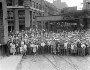 A large crowd poses for a photograph beside the Elevated around 1930, at the intersection of Harrison Avenue and Beach Street. The building at left is the Kingston Clothing Company. The event memorialized in the photo is unknown. (Photograph by Leslie Jones, courtesy of the Boston Public Library.)